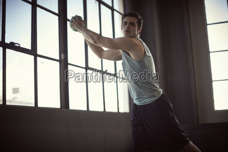 young man exercising with medicine ball