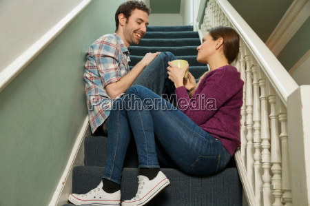 young couple sitting on staircase