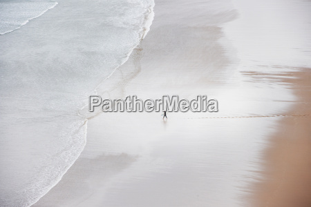 person alone on beach high angle