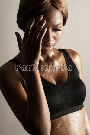 studio shot of woman with hand