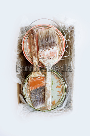 still life of paint brushes and