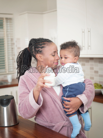 mother holding baby boy and baby