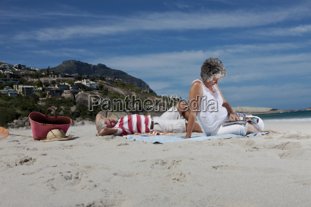 older couple relaxing together on beach