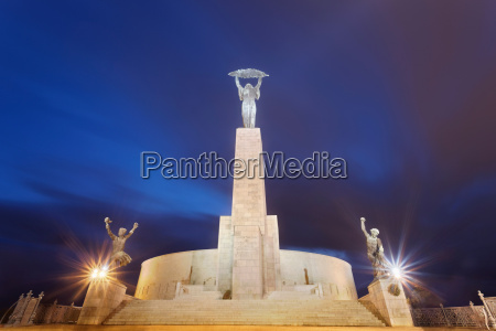 liberation monument lit up at night