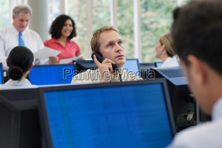 office worker using telephone in office