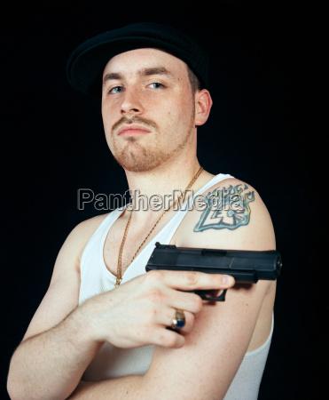young man holding gun portrait