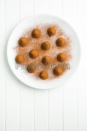 sweet chocolate truffles and cocoa powder