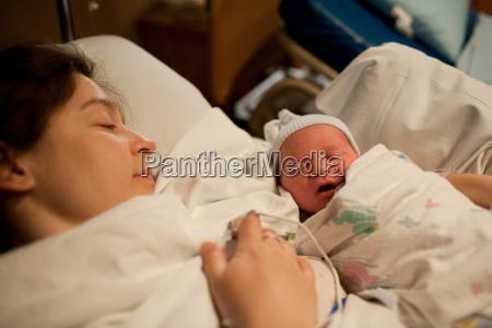 mother holding newborn baby boy in