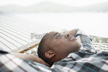 young man lying on hammock
