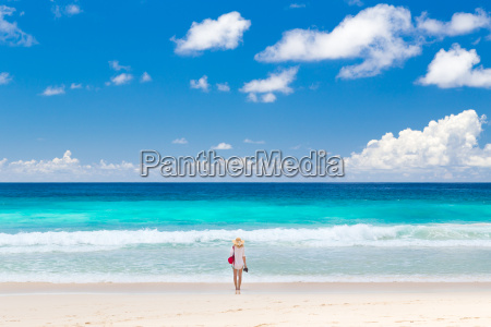 woman enjoying picture perfect beach on