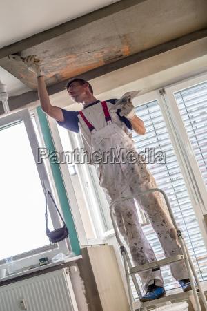 plasterer renovating indoor walls and ceilings