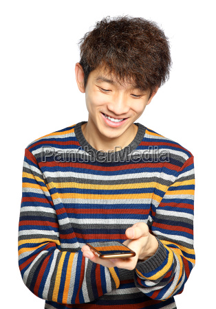 young man using mobile phone texting
