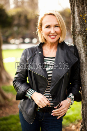 mature woman wearing leather jacket and