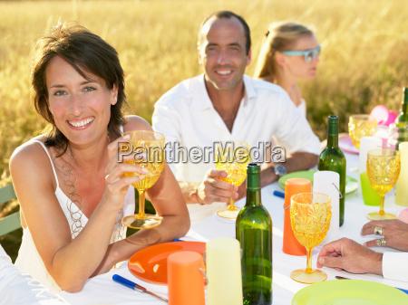 people having dinner woman portrait
