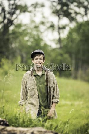 teen boy wearing flat cap in