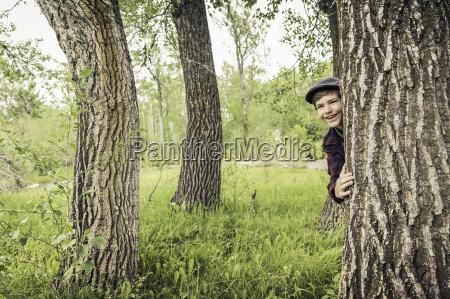 teen boy in forest wearing flat