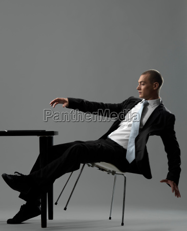 business man falling from chair