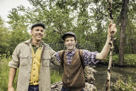 man and boy wearing flat caps