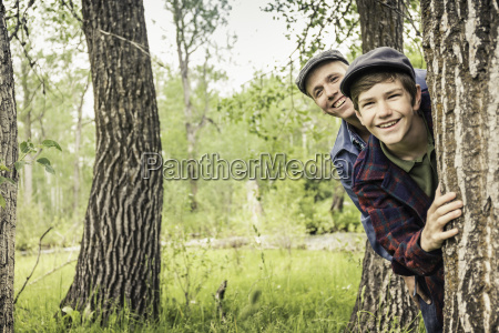 boy and man in forest wearing