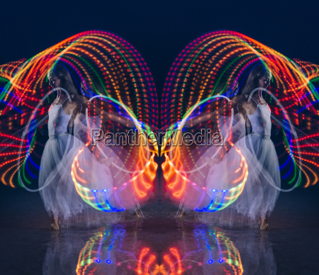 symmetrical composite of woman dancing with