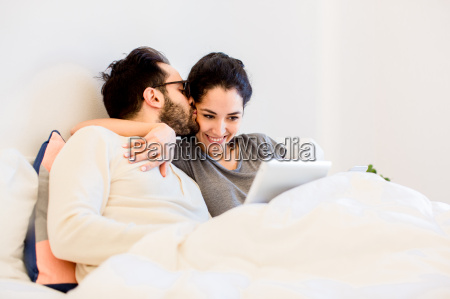 romantic young couple sitting up in