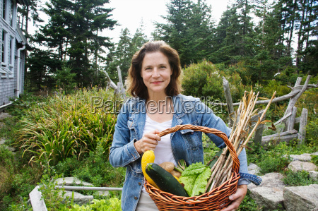 woman with organic garden vegetables
