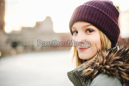 portrait of young woman wearing knitted