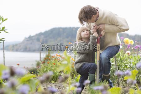 mature man and son digging organic