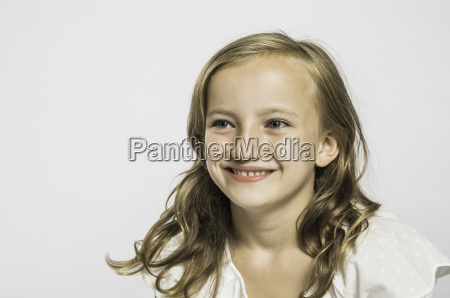 studio portrait of cute girl with