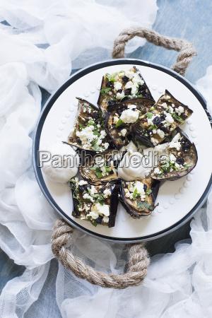 still life plate of stuffed aubergines