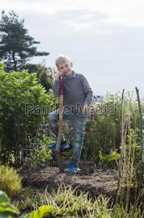 portrait of boy digging in organic