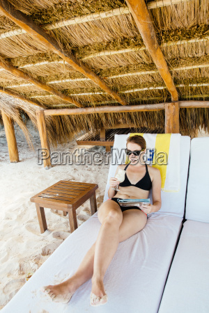 mid adult woman relaxing on sun