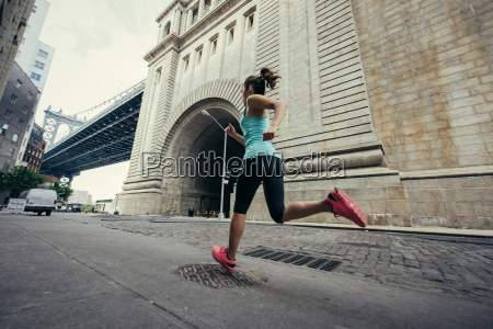 young female runner running in brooklyn