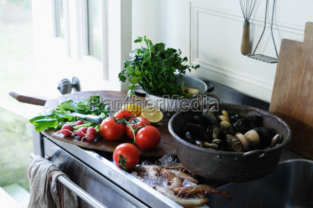 seafood and produce on kitchen counter