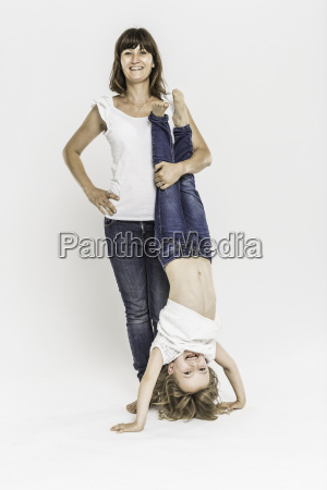 mother with daughter doing headstand