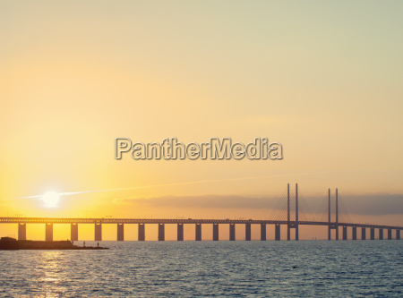 sunset view of oresund bridge between