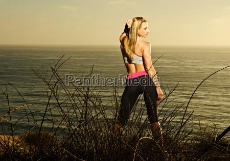 runner standing on dirt path