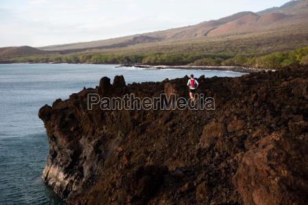 man running on rocky rural trail