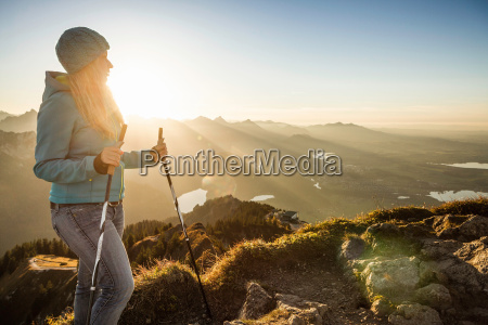 hiker standing on rocky hilltop