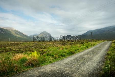 gravel road in rural landscape