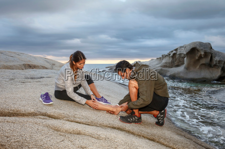 man examining girlfriends ankle