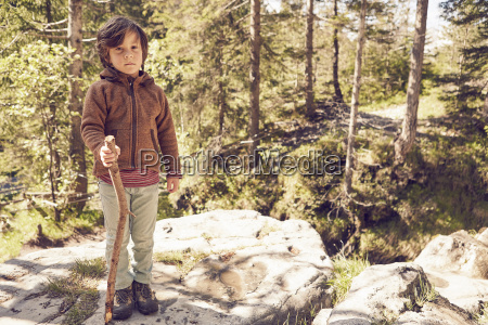 portrait of young boy in forest