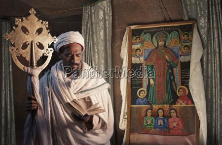 portrait of priest in church of