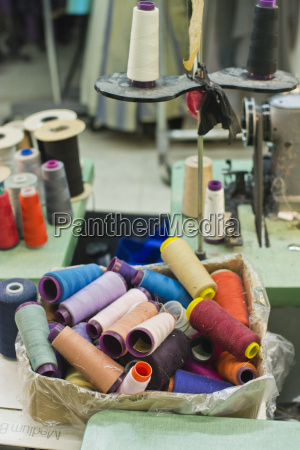 spools of colorful threads and sewing