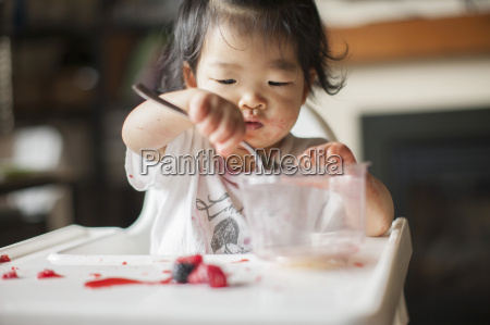 one year old baby girl eating