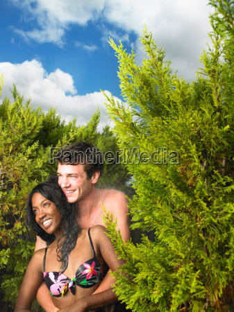 couple in swimsuits laughing
