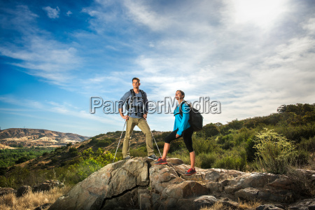 hikers standing on rock