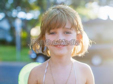child in fairy costume smiling