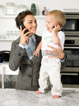 mother and baby son talking on
