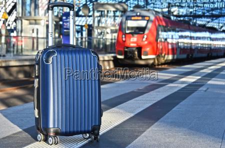 ttravel suitcase on the railroad platform